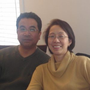 Husband and wife smiling at camera