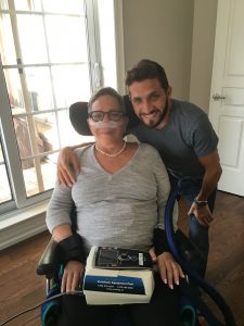 Jonathan Corber hugging mother, Wendy in her wheelchair